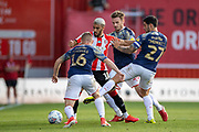 Brentford forward Said Benrahma (10) surrounded by Brentford players during the EFL Sky Bet Championship match between Brentford and Barnsley at Griffin Park, London, England on 22 July 2020.
