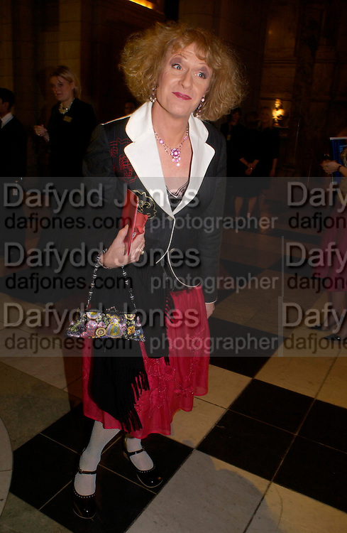 Grayson Perry. Beauty Week. -party launching week of lectures, debates, performances and events exploring notions of beauty. Includes a display of 26 objects from the V&A collections, selected by 'guest editor' Stephen Bayley, to examine notions of beauty in association with EstŽe Lauder. V. and A. South Kensington. 24 January 2005. ONE TIME USE ONLY - DO NOT ARCHIVE  © Copyright Photograph by Dafydd Jones 66 Stockwell Park Rd. London SW9 0DA Tel 020 7733 0108 www.dafjones.com