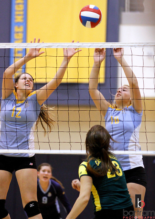 Heritage High's Nia Jogopulous, left, and Ali Stoltz reach to block a shot from Castro Valley's Bianca Higuera  during their playoff match at Heritage High School on Wednesday, Nov. 9, 2011. (Photo by Kevin Bartram).