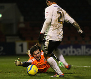 Picture by David Horn/Focus Images Ltd +44 7545 970036.15/01/2013.Lee Cook of Leyton Orient scores only to have it ruled out for off-side and Eldin Jakupovic of Hull City during the The FA Cup match at the Matchroom Stadium, London.