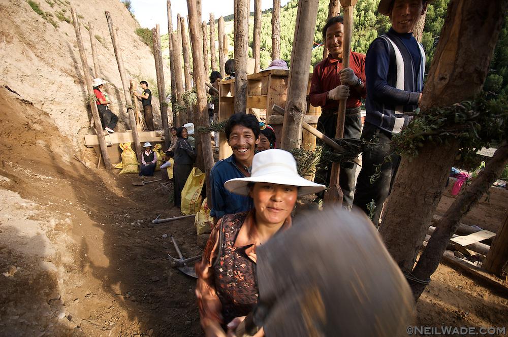 A Tibetan woman jokingly reacts to having her picture taken in Dege, Tibet.