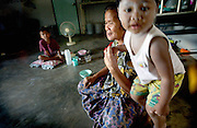 A mother and her children, all infected with Aids at an Aids relief centre in Tha Tako in Thailand, November 19, 2002.