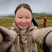 Teenage girl of the Dukha (Tsaatan) reindeer herder community, Mongolia. Approximately 200 families comprise the Tsaatan or Dukha community in northwestern Mongolia, whose existence is intimately linked to their herds of reindeer. Photo © Robert van Sluis