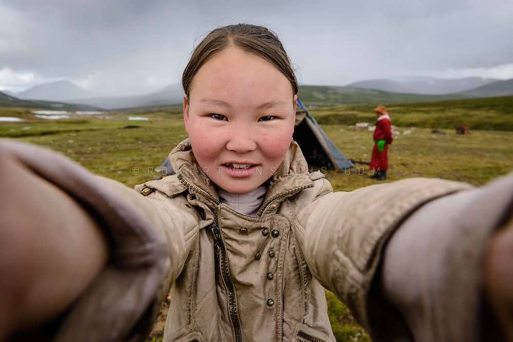 Teenage girl of the Dukha (Tsaatan) reindeer herder community, Mongolia. Approximately 200 families comprise the Tsaatan or Dukha community in northwestern Mongolia, whose existence is intimately linked to their herds of reindeer. Photo © Robert van Sluis