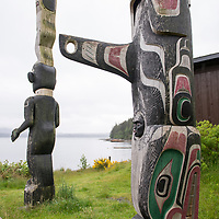 Totem poles outside of the U'Mista Cultural Centre in the tiny village of Alert Bay, Cormorant Island, British Columbia, Canada.