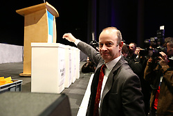 © Licensed to London News Pictures. 17/02/2018. Birmingham, UK. Henry Bolton casts his vote at the ukip egm. Ukip is holding an EGM today at the International Convention Centre in Birmingham to decide weather the party members will either back Henry Bolton as the party leader or endorse the No Confidence vote of the National Executive Committee. Photo credit: Andrew McCaren/LNP