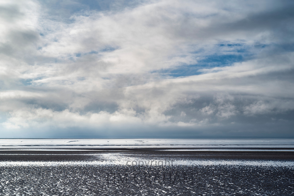 Pastel shades of sea and sandy beach of the Bristol Channel at Burnham-on-Sea, Somerset, UK
