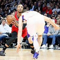 12 December 2016: Portland Trail Blazers guard Damian Lillard (0) eyes the basket during the LA Clippers 121-120 victory over the Portland Trail Blazers, at the Staples Center, Los Angeles, California, USA.