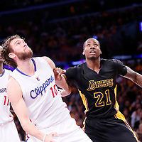 31 October 2014: Los Angeles Lakers forward Ed Davis (21) vies for the rebound with Los Angeles Clippers forward Spencer Hawes (10) during the Los Angeles Clippers 118-111 victory over the Los Angeles Lakers, at the Staples Center, Los Angeles, California, USA.