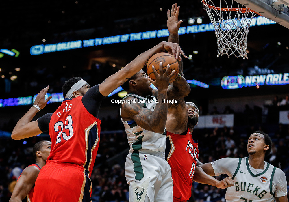Dec 13, 2017; New Orleans, LA, USA; New Orleans Pelicans forward Anthony Davis (23) blocks a shot by Milwaukee Bucks guard Eric Bledsoe (6) as center DeMarcus Cousins (0) defends during the first quarter at the Smoothie King Center. Mandatory Credit: Derick E. Hingle-USA TODAY Sports
