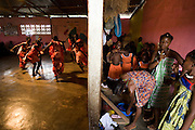 Members of the Liberian Dance Troupe (LDT) perform traditional dancing while others prepare backstage at the Buduburam refugee settlement, roughly 20 km west of Accra, Ghana's capital, on Saturday April 14, 2007. One of the main goals of the LDT is to teach young refugee children, many of which have never seen Liberia, about their country's music, dance and culture. The Buduburam refugee settlement is still home over 30,000 Liberians, most of which have mixed feelings about returning to Liberia.