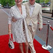 NLD/Amsterdam/20110731 - Premiere circus Hurricane met Hans Klok, Henk van der Meyden en partner Monica Strotmann