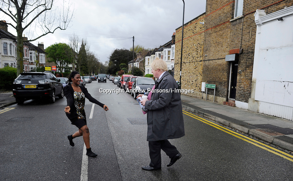 A woman runs a cross the road to give Boris a hug as  The London Mayor Boris Johnson campaign's in Penge, South London, during his Mayor Campaign, Wednesday April 25, 2012 Photo By Andrew Parsons /i-Images