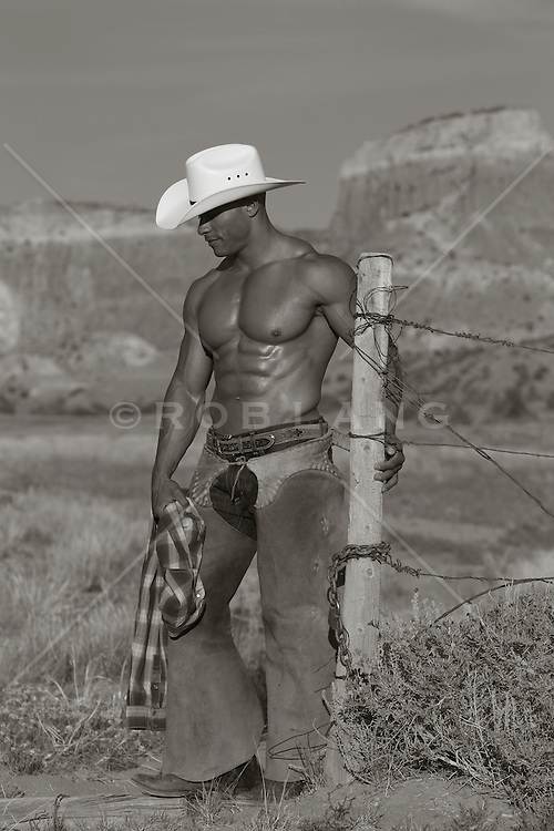 sexy and rugged African American Cowboy outdoors without a shirt