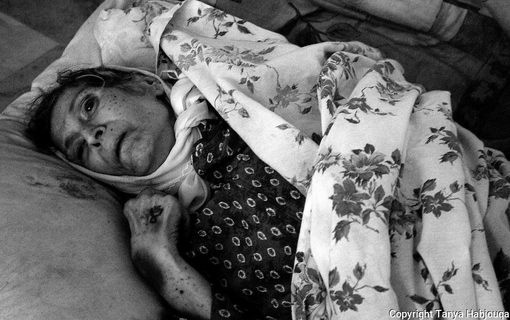 After a temporary cease fire from Israel, the Lebanese civil defense could finally access what had been a no go area--Bint Jebeil--where scores of families had been trapped under intense aerial bombardment as well as a land battle between Hezbollah and the IDF.....this 80 year old woman, Amana Shameen, died in the night in her bed, leaving her 85 year old husband and grand daughter distraught. They had been trapped under the 20 day siege without food or water.....The Lebanese civil defense pulled her body out for burial....