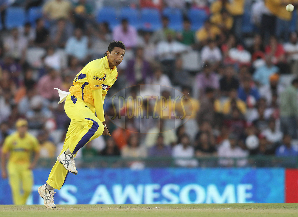 Suraj Randiv of the Chennai Super Kings sends down a delivery during match 9 of the Indian Premier League ( IPL ) Season 4 between the Kings XI Punjab and the Chennai Super Kings held at the PCA stadium in Mohali, Chandigarh, India on the 13th April 2011..Photo by Shaun Roy/BCCI/SPORTZPICS