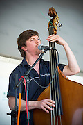 A musician plays for a crowd at the Kingman Island Bluegrass Festival in Washington, DC.