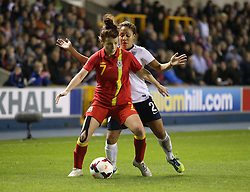 Wales's Angharad James - Bristol Academy holds off England's Alex Scott (Arsenal) - Photo mandatory by-line: Robin White/JMP - Tel: Mobile: 07966 386802 26/10/2013 - SPORT - FOOTBALL - The Den - Millwall - England Women v Wales Women - World Cup Qualifier - Group 6