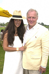 MR & MRS DAVE GILMOUR he is the musician at a polo match in Sussex on 23rd July 2000.OGI 75