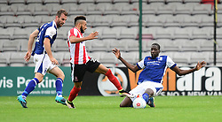 Lincoln City's Nathan Arnold is tackled by Barrow's Moussa Diarra<br /> <br /> Picture: Chris Vaughan/Chris Vaughan Photography<br /> <br /> Football - Vanarama National League - Lincoln City Vs Barrow - Saturday 17th September 2016 - Sincil Bank - Lincoln<br /> <br /> Copyright © 2016 Chris Vaughan Photography. All rights reserved. Unit 11, Churchill Business Park, Bracebridge Heath, Lincoln, LN4 2FF - Telephone: 07764170783 - info@chrisvaughanphotography.co.uk - www.chrisvaughanphotography.co.uk