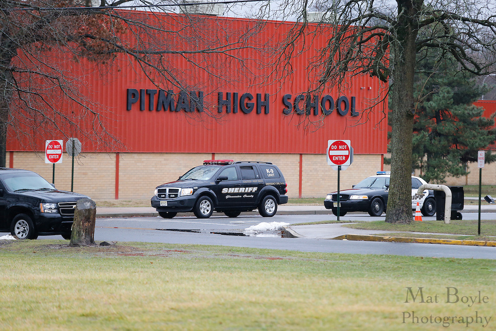 Gloucester County Sheriff vehicles leave Pitman High School after checking a threat of a school shooting in Pitman, NJ on Monday January 6, 2014. (photo / Mat Boyle)