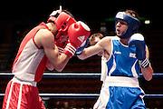 Milan, 04-09-2009 ITALY - Aiba World Boxing Championship Milan 2009.  Fly 51 kg preliminaries..Pictured:  Picardi Vincenzo ITA blue vs Martinez Fernando ARG red.Photo by Giovanni Marino/OTNPhotos . Obligatory Credit