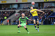 Oxford United's Callum O'Dowda beats Forest Green's David Pipe to the ball during the The FA Cup match between Oxford United and Forest Green Rovers at the Kassam Stadium, Oxford, England on 6 December 2015. Photo by Shane Healey.