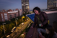 From a roof top, residents watch the demonstration. Independentists rally thousands in Barcelona in support of their former leadership sent to jail by Spanish court following the Catalan Parliament proclamation of independence. November 11, 2017 in Barcelona, Spain.