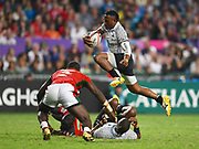 Fijian player Amenoni Nasilasila leaps over a pack of players to quickly play the ball during the Cathay Pacific/HSBC Hong Kong Sevens festival at the Hong Kong Stadium, So Kon Po, Hong Kong. on 8/04/2018. Picture by Ian  Muir.