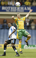 Photo: Aidan Ellis.<br /> Sheffield Wednesday v Norwich City. Coca Cola Championship. 06/05/2007.<br /> Norwich's Andy Hughes wins the header in front of Wednesday's Jermain Johnson