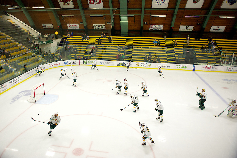 The Catamounts warm up before the start of the mens hockey game between the Providence Friars and the Vermont Catamounts at Gutterson Field House on Saturday night November 3, 2012 in Burlington, Vermont.