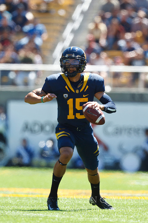 BERKELEY, CA - SEPTEMBER 08: Quarterback Zach Maynard #15 of the California Golden Bears scrambles out of the pocket against the Southern Utah Thunderbirds during the second quarter at Memorial Stadium on September 8, 2012 in Berkeley, California. The California Golden Bears defeated the Southern Utah Thunderbirds 50-31. (Photo by Jason O. Watson/Getty Images) *** Local Caption *** Zach Maynard
