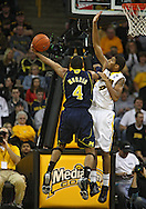 February 19 2011: Michigan Wolverines guard Darius Morris (4) puts up a shot as Iowa Hawkeyes guard/forward Roy Devyn Marble (4) defends during the first half of an NCAA college basketball game at Carver-Hawkeye Arena in Iowa City, Iowa on February 19, 2011. Michigan defeated Iowa 75-72 in overtime.