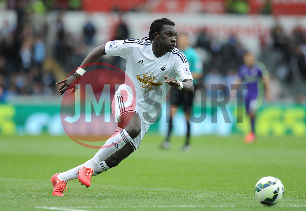 Swansea City's Bafetibis Gomis in action. - Photo mandatory by-line: Alex James/JMP - Mobile: 07966 386802 - 17/05/2015 - SPORT - Football - Swansea - The Liberty stadium - Swansea City v Manchester City - Barclays premier league