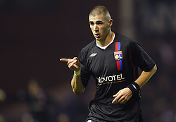 Olympique Lyonnais' Karim Benzema gestures after scoring his second goal during the UEFA Champions League soocer match, Group E, Rangers vs Olympique Lyonnais at the Ibrox Stadium in Glasgow, UK on December 12, 2007. Olympique Lyonnais won 3-0. Photo by Christian Liewig/Cameleon/ABACAPRESS.COM