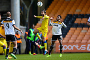 AFC Wimbledon defender George Francomb (7) wins the header during the EFL Sky Bet League 1 match between Port Vale and AFC Wimbledon at Vale Park, Burslem, England on 1 April 2017. Photo by Simon Davies.