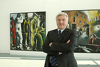 """14 APR 2003, BERLIN/GERMANY:<br /> Frank-Walter Steinmeier, SPD, Staatssekretaer, Chef Bundeskanzleramt, vor Gemaelden """"Maenner bei der Arbeit"""" (L) und """"Die dritte Wirklichkeit"""" (R) von Dieter Hacker, Bundeskanzleramt<br /> IMAGE: 20030414-01-008<br /> KEYWORDS: Staatssekretär, Kunst, Kunstwerk, Bild, Gemälde"""