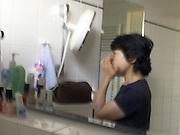 woman doing her makeup blurry