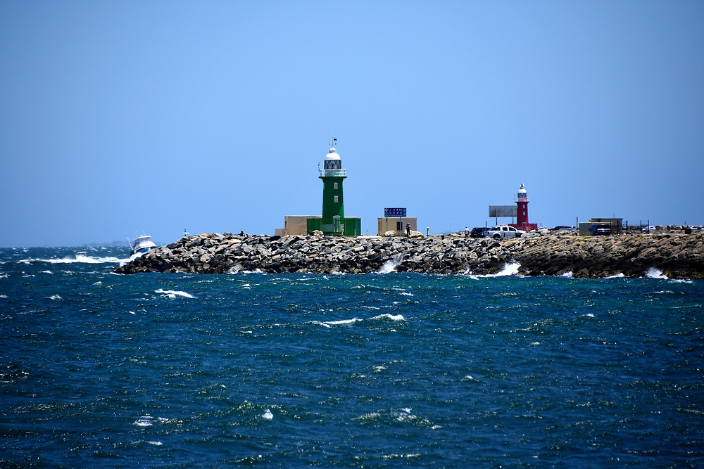 Starboard green and Port left lighthouse on a breakwater at the entrance to Freemantle harbour