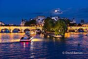 Full moon rising over Ile de la Cité, Pont Neuf, Seine, Paris, France