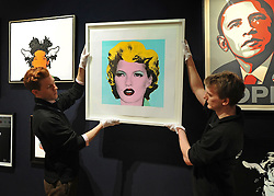 © Licensed to London News Pictures. 23/03/2012. London, UK. Bonham's staff George Foren (L) and Matthew Fancy hang one of the highlights of the sale, a screen print of British supermodel Kate Moss, 2005, inspired by Andy Warhols iconic Marilyn Monroe series, which has been estimated at £30,000  50,000. A photocall of Bonham's Urban Art Sale including Seventeen art works by the celebrated graffiti artist, Banksy, which are to be sold at Bonhams, London, ahead of the Urban Art Sale, which takes place on 29 March 2012. . Photo credit : Stephen SImpson/LNP