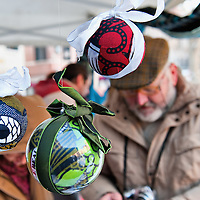 "VENICE, ITALY - DECEMBER 18:  A selection Chrsitmas baubles made with Tanzanian fabrics for sale at ""l'Altro Natale"" Christmas market on December 18, 2010 in Venice, Italy. ""L'Altro Natale"" an alternative Christmas market organised over the busiest shopping week end of the year promotes fair trade and alternative commerce."