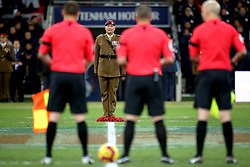 A member of the armed forces during a minutes silence for Armistice Day and also the victims of the Leicester helicopter crash, which included Leicester Chairman, Vichai Srivaddhanaprabha