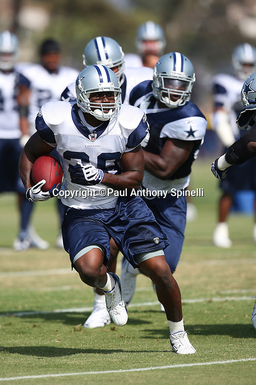 OXNARD, CA - AUGUST 01:  Rookie running back Felix Jones #28 of the Dallas Cowboys runs the ball during the 2008 Dallas Cowboys Training Camp at River Ridge Field on August 1, 2008 in Oxnard, California. ©Paul Anthony Spinelli *** Local Caption *** Felix Jones