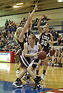 Monticello's Brooke Stahlberg (2) is surrounded by North-Linn's Laura Moorman (13), Jenna Schade (43), and Amanda Aberle (35) during their Rivalry Saturday game at Washington High School at 2205 Forest Drive SE in Cedar Rapids on Saturday, January 21, 2012. (Stephen Mally/Freelance)