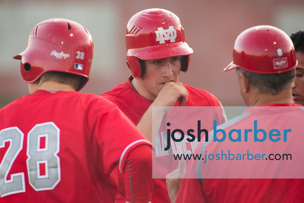 Mater Dei's Blake Hunt (28) Grant Burton (25) during a Trinity League game at Mater Dei High School on Friday, May 1, 2015 in Santa Ana, Calif. (Photo/Josh Barber)
