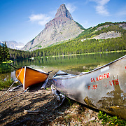 Canoes on Swiftcurrent Lake near Many Glacier Hotel, Glacier National Park, Montana.