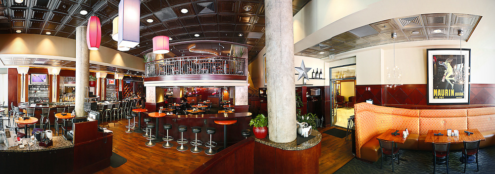 SHOT 7/18/12 11:09:00 AM - Panoramic image of the interior of Rialto Cafe located on the 16th Street Mall in downtown Denver, Co. Rialto Cafe puts a contemporary spin on classic American favorites and is inspired by the Hollywood Era of bright lights featuring an atmosphere that is warm and inviting with its rich mahogany bar, warm tabletops, and eclectic light fixtures - reminiscent of the elegant style and cool sophistication of the 40s. (Photo by Marc Piscotty / © 2012)