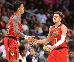 January 6, 2019 - Atlanta, GA, USA - Atlanta Hawks guard Trae Young gets five from John Collins in the final minutes of a 106-82 victory over the Miami Heat on Sunday, Jan. 6, 2019 at State Farm Arena in Atlanta, Ga. (Credit Image: © Curtis Compton/Atlanta Journal-Constitution/TNS via ZUMA Wire)