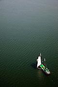 Nederland, Noord-Holland, Waterland, 28-04-2010; Zeilschip (charter) gaat overstag op het Markermeer, ter hoogte van Uitdam..Sailboat is tacked on  inner sea IJsselmeer, near Uitdam.luchtfoto (toeslag), aerial photo (additional fee required).foto/photo Siebe Swart